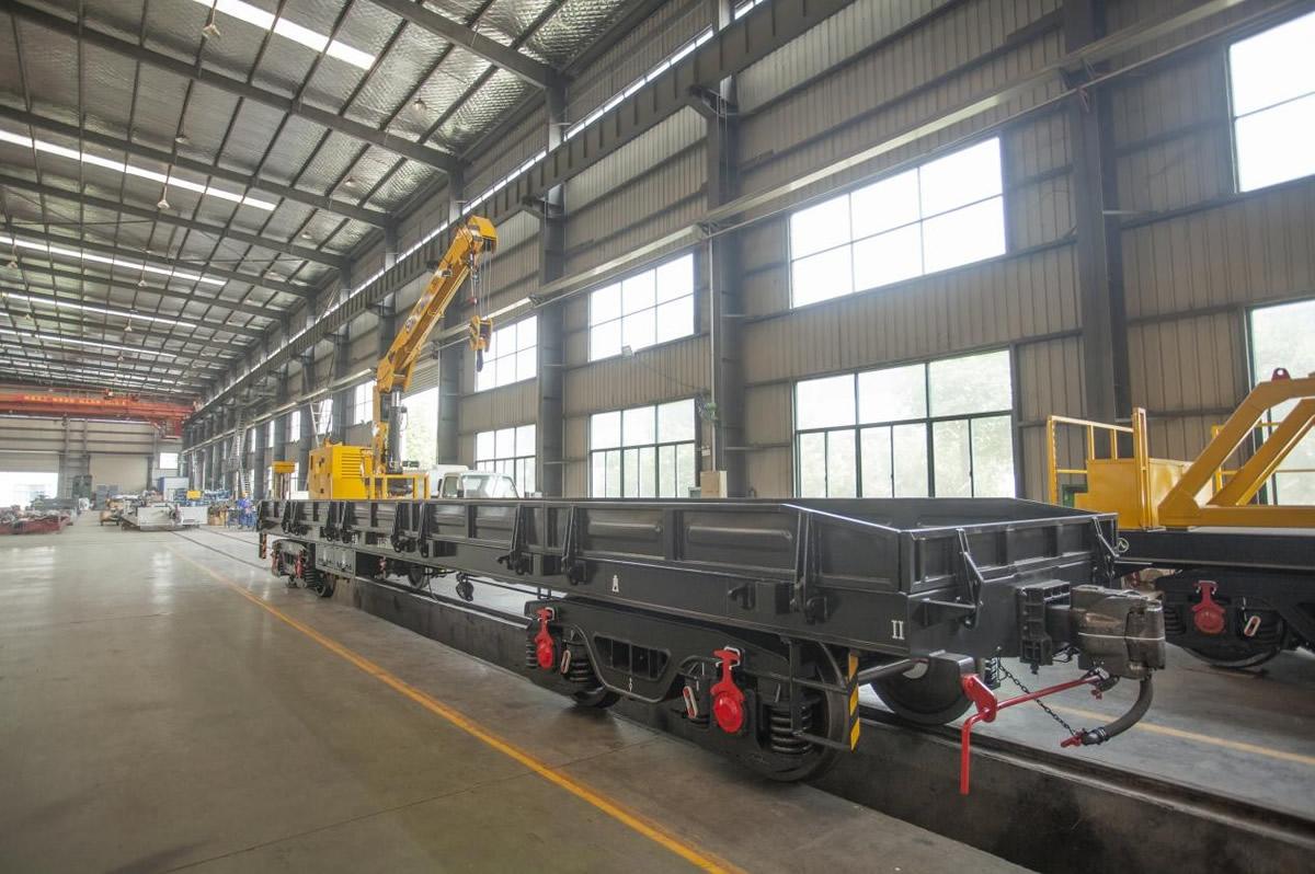 Crane mounted flatcar