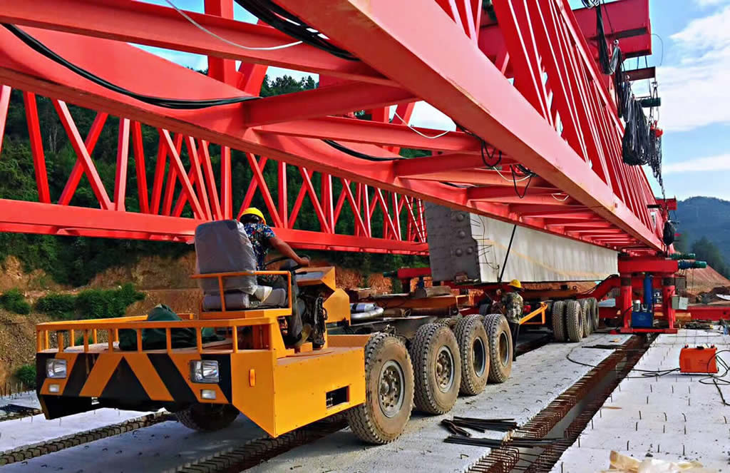 Long beam trailer moving under lunching girder