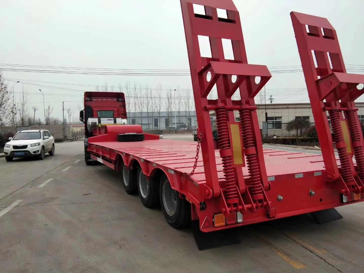 Mechanical loading ramp low bed trailer