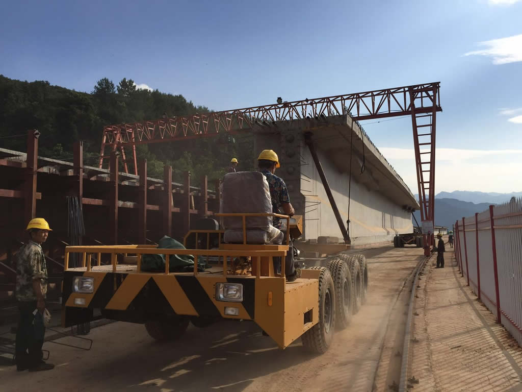 Precast bridge section transporter
